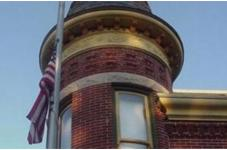 Flag in front of a historic building